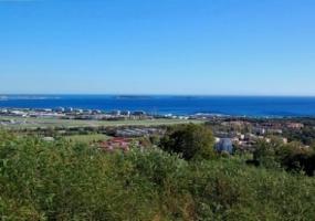 Vente terrain Mandelieu vue mer - Rare et magnifique terrain plat de 3354m² sur les hauteurs de Mandelieu bénéficiant d' une splendide vue panoramique sur les Iles de Lérins